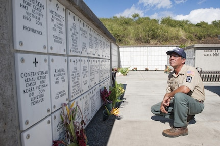 Chris Farley, U.S. Navy veteran and National Memorial Cemetery of the Pacific (NMCP) caretaker, reads names of fallen service members at the NMCP Nov. 28, 2015, in Honolulu. Farley is a U.S. Navy veteran who served from 1982 to 1987 as an air traffic controller. He is responsible for the maintenance of the 112.5 acres of land that make up the cemetery, the 56,971 gravesites of those who are interred in-ground or in-columbarium, and the 28,788 fallen who are memorialized in the courts of the missing. (U.S. Air Force photo by Staff Sgt. Christopher Hubenthal)