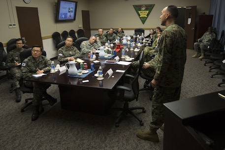 U.S. Marine Corps Col. Peter Lee informs representatives of the United Nations Command Nov. 5 on capabilities and operations Marine Corps Air Station Futenma, Okinawa, Japan. The briefing contained information about flight line capabilities and future relocation plans. The representatives were then escorted on a windshield tour of the base. Lee, a New Rochelle, N.Y., native is the commanding officer of MCAS Futenma.