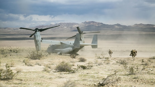 A Marine with Transportation Services Company, Combat Logistics Battalion 2, carries a simulated casualty to an MV-22 Osprey for a medical evacuation during a live-fire vehicle recovery exercise as part of Integrated Training Exercise 1-16 at Marine Air Ground Combat Center Twentynine Palms, Calif., Nov. 4, 2015. The training tested the Marines' ability to effectively recover a downed vehicle while engaging the enemy in a live-fire scenario.