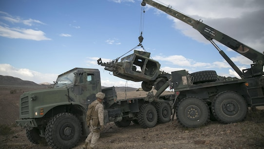 Marines with Transportation Services Company, Combat Logistics Battalion 2, load a wrecked vehicle during a live-fire vehicle recovery exercise as part of Integrated Training Exercise 1-16 at Marine Air Ground Combat Center Twentynine Palms, Calif., Nov. 4, 2015. During ITX, Marines demonstrate core essential tasks and conduct offensive and defensive stability operations.