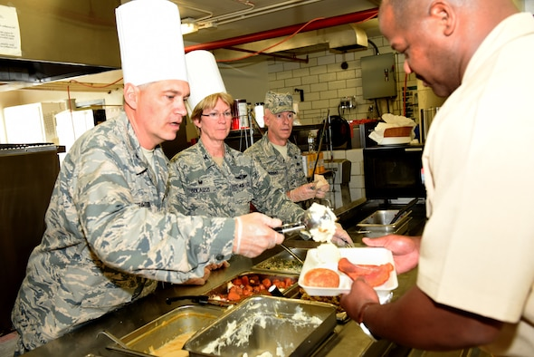 Col. Douglas N. Strawbridge, 911th Airlift Wing vice wing commander, serves Airmen the annual Thanksgiving meal with Col. Sharon Colaizzi, 911th Aeromedical Staging Squadron commander, at the Pittsburgh International Airport Air Reserve Station, Nov. 7, 2015. Commanders traditionally serve the holiday meal to 911th AW Airmen to promote teamwork and camaraderie. (U.S. Air Force photo by Senior Airman Marjorie A. Bowlden)