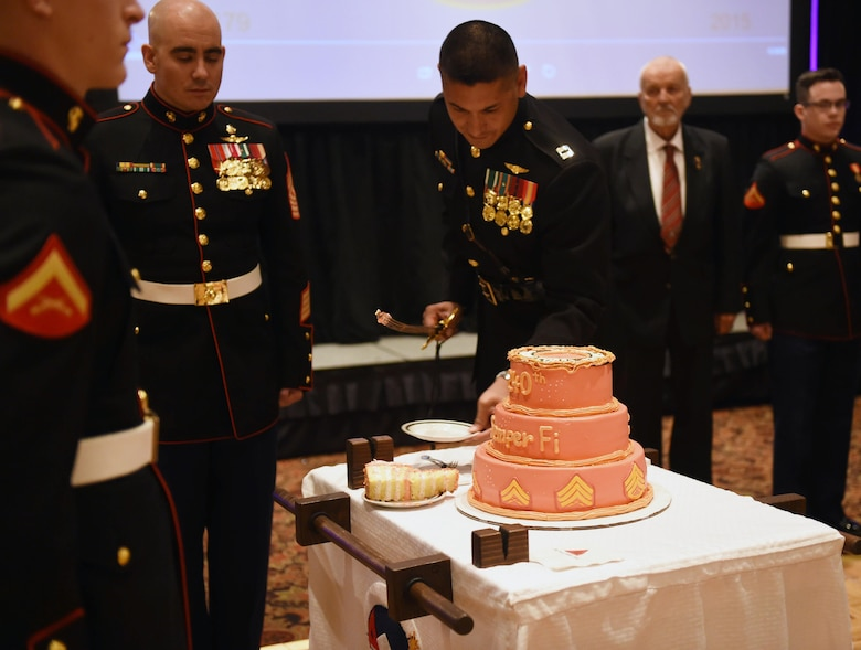 Capt. David Rubio, Company A, Marine Cryptologic Support Battalion commanding officer, cuts the cake during the Marine Corps Birthday Ball Nov. 6, 2015, at the Denver Athletic Club, Denver. The ball was held in honor of the Marine Corps' 240th birthday, complete with a guest speaker, dinner and dancing. (U.S. Air Force photo by Airman 1st Class Samantha Meadors/Released)
