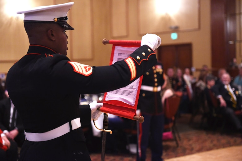 A member of the Company A, Marine Cryptologic Support Battalion reads Lt. Gen. John Lejeune's birthday message during the Marine Corps Birthday Ball Nov. 6, 2015, at the Denver Athletic Club, Denver.  Lejeune, 13th Commandant of the U.S. Marine Corps, ordered the message be read every year during the Marine Corps birthday to honor the history, mission and tradition of the Corps. (U.S. Air Force photo by Airman 1st Class Samantha Meadors/Released)