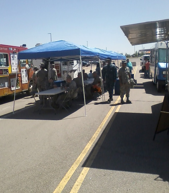 Buckley personnel use options provided by the food trucks for lunch June 17, 2015, on Buckley Air Force Base, Colo.  Food trucks bring more food options for Buckley personnel and are accessible when The Exchange is closed. (Courtesy photo)