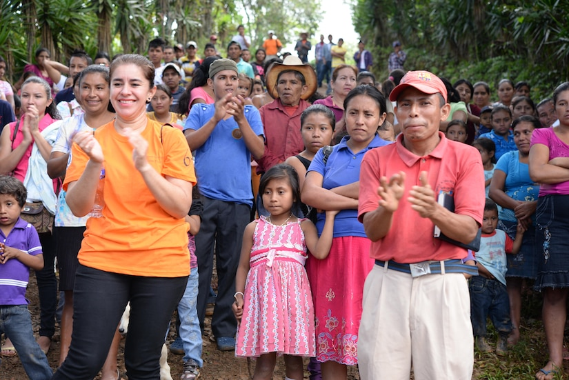 Locals from Las Moras, Comayagua, Honduras, applaud U.S. military members and civilians as they finish hiking in food and supplies during Chapel Hike 64, Oct. 31, 2015. Chapel Hikes take place every six weeks and provide community outreach by bringing much needed food and supplies to the less fortunate. (U.S. Air Force photo by Senior Airman Westin Warburton/Released)