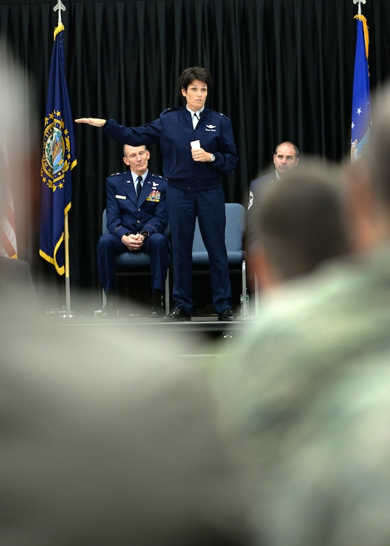 Longtime member of the New Hampshire Air National Guard, Brig. Gen. Laurie Farris speaks to those attending her promotion ceremony in Hangar 254 on base Nov. 7. In her new position as the N.H. ANG chief of staff, Farris will be responsible for the direction and coordination of staff activities for Joint Force Headquarters. (U.S. Air National Guard photo by Senior Airman Kayla McWalter)
