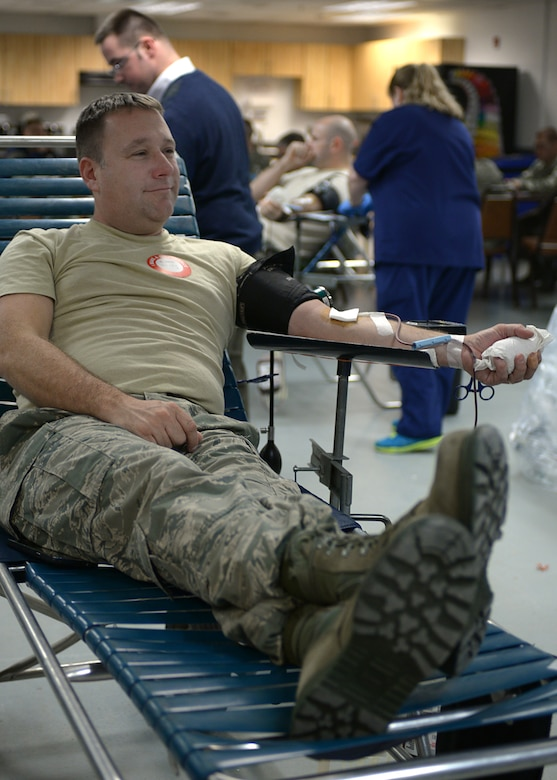 Senior Master Sgt. Jeremy Mercier, 157th Air Refueling Wing Small Air Terminal superintendent, donates blood during a blood drive on base Nov. 7, 2015. The blood drive, which was held in Hanger 254, was a community project the Pease Rising Five professional development group. (U.S. Air National Guard photo by Airman 1st Class Ashlyn J. Correia)