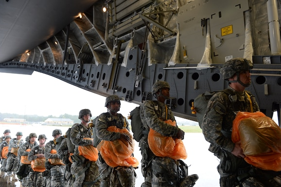 Approximately 200 members from U.S. Army?s 82nd Airborne?s Division partnered with 18th Air Force?s Joint Base Charleston, S.C., C-17 Globemaster III crews for a practice jump over Pope Air Force Base, N.C., Nov. 2, 2015 in preparation for Exercise Ultimate Reach Nov. 2-8 in Spain. Ultimate Reach is an annual U.S. Transportation Command-sponsored live-fly exercise designed to exercise the ability of 18th Air Force?s transportation units to plan and conduct strategic airdrop missions. This year?s rendition of Ultimate Reach partners with NATO Exercise Trident Juncture, which is currently being held throughout locations in Europe. The exercise serves to enhance the 18th Air Force?s interoperability and partnership with NATO allies and sister services. (U.S. Air Force photo by Senior Airman Christopher Reel/ not reviewed)