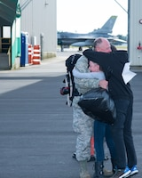 U.S. Air Force Master Sgt. John Kirkpatrick, from the 158th Fighter Wing, returns to his family at Vermont Air National Guard Base after a four-month long deployment to the Pacific, Oct. 19, 2015. Theater Security Packages to the Asian-Pacific show the U.S. commitment to the regional security and stability for disaster relief, global situational awareness, combating piracy, active defense and power projection. (U.S. Air National Guard photo by Master Sgt. Dan DiPietro)