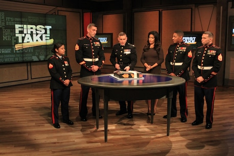 1st Lt. Stefan Milan, center left, explains the Marine Corps Birthday Cake Cutting Ceremony on ESPN First Take to Molly Qerim, Nov. 5. The Marines, all from Marine Recruiting Station Springfield, 1st Marine Corps District, appeared on the show in light of the Marine Corps' 240th birthday taking place on Nov. 10. (Official Marine Corps Photo by Staff Sgt. Richard Blumenstein)