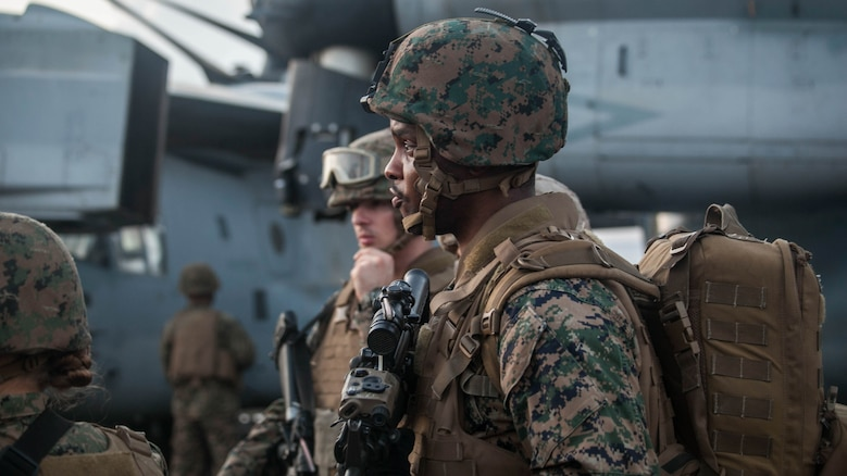 Marines and sailors with the 15th Marine Expeditionary Unit wait for directions during a mass-casualty drill on the flight deck of the USS Essex (LHD 2).The Marines and Sailors honed their skills to become quicker and more efficient should a situation arise where medical attention is needed. The 15th MEU is currently deployed in the Indo-Asia-Pacific region to promote regional stability and security in the U.S. 7th Fleet area of operations.