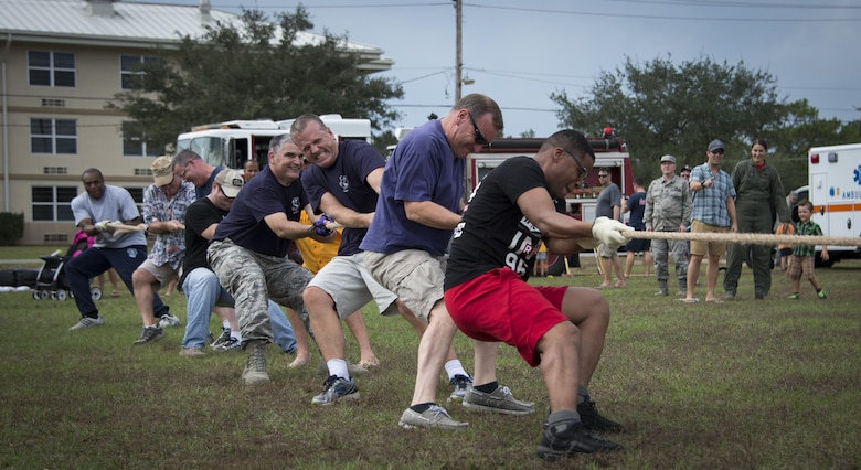 Members of the 919th Special Operations Wing give it their all in the final round of tug of war during the Duke Field Wing Day event Nov. 7.  The 919th SOW sets aside a special day each year to show appreciation for its reservists and their family members. Events included music, sports, children's games, etc. (U.S. Air Force photo/Tech. Sgt. Jasmin Taylor)
