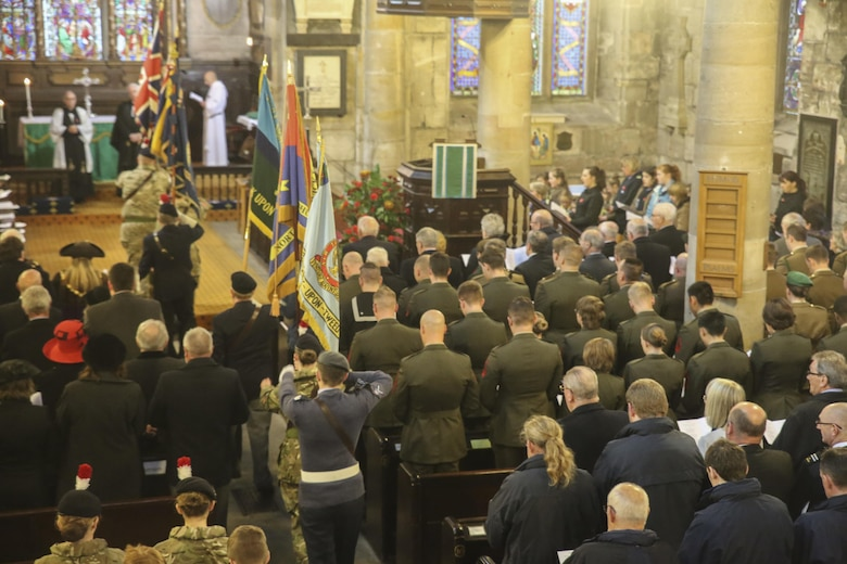 U.S. Marines with 2nd Intelligence Battalion and British service members and citizens gather for a Remembrance Day memorial service in Berwick-upon-Tweed, U.K., Nov. 8, 2015. Remembrance Day is a yearly holiday which commemorates service members who have sacrificed their lives in previous wars. (U.S. Marine Corps photo by Cpl. Lucas Hopkins/Released)