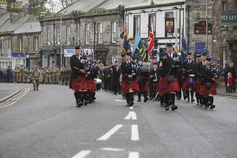 British service members and U.S. Marines with 2nd Intelligence Battalion march during a Remembrance Day Parade in Berwick-upon-Tweed, U.K., Nov. 8, 2015. The forces came together to commemorate service members who sacrificed their lives in war. (U.S. Marine Corps photo by Cpl. Lucas Hopkins/Released)