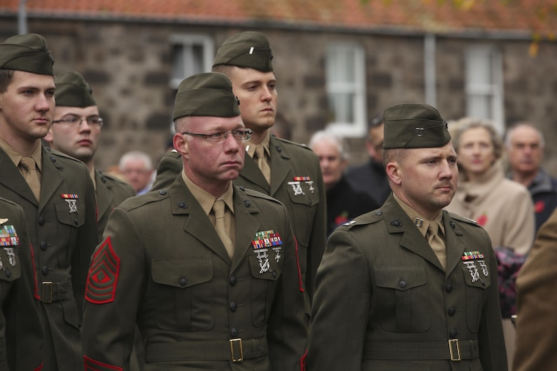 U.S. Marines with 2nd Intelligence Battalion stand at attention during a Remembrance Day Parade in Berwick-upon-Tweed, U.K., Nov. 8, 2015. The Marines gathered with various U.K. services to march in the parade, which commemorates service members who sacrificed their lives in war. (U.S. Marine Corps photo by Cpl. Lucas Hopkins/Released)