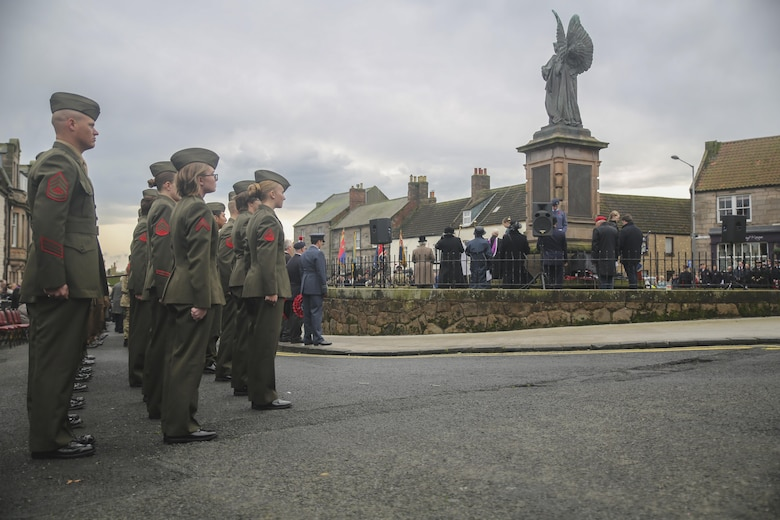 U.S. Marines with 2nd Intelligence Battalion stand at attention during a Remembrance Day Parade in Berwick-upon-Tweed, U.K., Nov. 8, 2015. Since the ending of World War I, the United Kingdom has celebrated the holiday, which honors service members who sacrificed their lives in war. (U.S. Marine Corps photo by Cpl. Lucas Hopkins/Released)