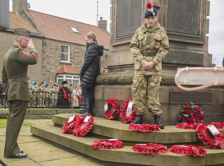 U.S. Marine First Sgt. Timothy Austin, left, the senior enlisted advisor of Exercise Phoenix Odyssey II, salutes a war memorial in Berwick-upon-Tweed, U.K., Nov. 8, 2015. Approximately 25 Marines marched alongside British service members during a Remembrance Day Parade, a holiday which commemorates service members who sacrificed their lives in war. The Marines concluded Exercise Phoenix Odyssey with British soldiers Nov. 6, which was designed to enhance joint intelligence operations. (U.S. Marine Corps photo by Cpl. Lucas Hopkins/Released)