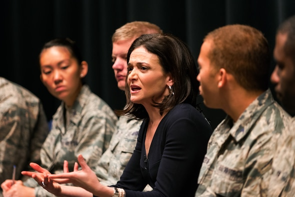 Sheryl Sandberg, the chief operating officer of Facebook, chats with cadets on the stage at Arnold Hall Nov. 6, 2015. Sandberg was at the Air Force Academy to discuss Lean-In Circles, a peer networking program she created that is being used by the Defense Department. (U.S. Air Force photo/Liz Copan)