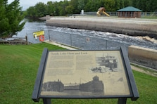 The Sandy Lake Recreation Area is situated at the outlet of Big Sandy Lake, about 120 miles north of Minneapolis. It is located on the canoe route that linked Lake Superior and the Mississippi River. When the dam was built in 1859, it included a lock to pass boat traffic through. This was the farthest north a lock had been built. Today, the lock house has been renovated to display interpretive exhibits and artifacts.   The well maintained and clean recreation area offers boating, fishing, camping, picnicking, interpretive programs and playground areas. There are both camp and tent sites. About half of the camping sites are located near the shoreline of Big Sandy Lake and Sandy River, which gives campers easy access to the water. The designated beach located on Big Sandy Lake shoreline is a great place to relax and escape the scorching heat.   Three boat ramps are placed around the lake to give access to the river and lake. The fishing sites are isolated from the camp sites so that there is an increased chance of catching fish due to less noise. It also provides a beautiful view of the lake.   There is also a trail on the opposite side of the dam from the camp sites. This trail provides a bit of isolation and release from the hectic lifestyle.