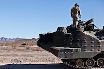 U.S. 1st Marine Division, Alpha Company, 3D Amphibious Assault Battalion conducts their Amphibious Assault Vehicle qualifications tables 1-9 for the first time at Yuma Proving Grounds, Ariz., on Nov. 7, 2015.  Alpha Company is conducting this training in preparation for future deployments. (U.S. Marine Corps photo taken by LCpl. AaronJames B. Vinculado/Released)