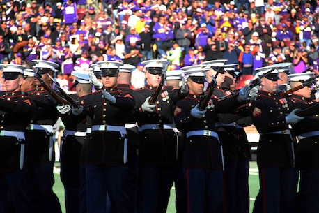 Marines with the Silent Drill Platoon performed at the MN Vikings game, November 8. In addition to performing a spectacular half-time show, the Marines also honored Tyler Johnson, a high school student from Minneapolis, selected to play in the Semper Fi All American Bowl.