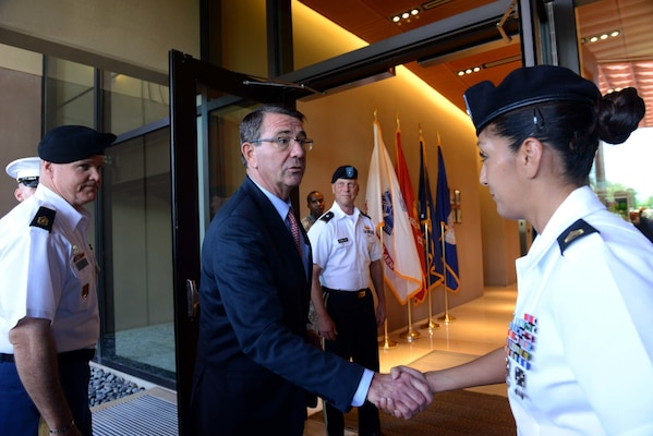 Secretary of Defense Ash Carter greets U.S. Army Staff Sgt. Claudia Smallman, Defense POW/MIA Accounting Agency recovery noncommissioned officer.  While at DPAA, he spoke with service members about the importance of the agency's joint mission in the Indo-Asia Pacific region. The mission of the Defense POW/MIA Accounting Agency is to provide the fullest possible accounting for our missing personnel to their families and the nation. (U.S. Air Force photo by Staff Sgt. La'Shanette Garrett)