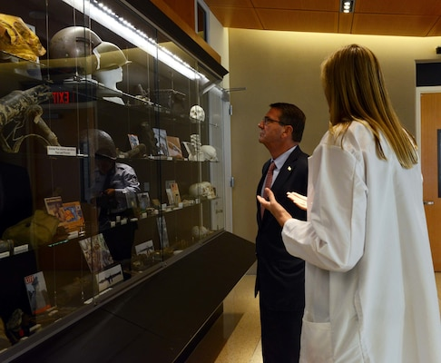 Dr. Debra Zinni, Defense POW/MIA Accounting Agency forensic anthropologist, speaks about artifacts stored in the DPAA laboratory with Secretary of Defense Ash Carter. While at DPAA, he spoke with service members about the importance of the agency's joint mission in the Indo-Asia Pacific region. The mission of the Defense POW/MIA Accounting Agency is to provide the fullest possible accounting for our missing personnel to their families and the nation. (U.S. Air Force photo by Staff Sgt. La'Shanette Garrett)