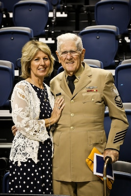 Diane Rogers Calhoun, of Hixson, Tenn., stands next to her father, retired Navy Senior Chief Electronics Technician Lee Rogers, at a memorial service for service members held Aug. 15, 2015, at the McKenzie Arena in Chattanooga.