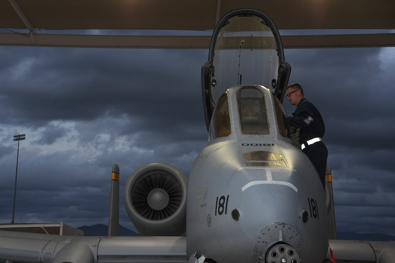 U.S. Air Force Airman 1st Class Bryan Betz, 355th Aircraft Maintenance Squadron assistant dedicated crew chief, covers the A-10C Thunderbolt II throttle at Davis-Monthan Air Force Base, Ariz., Nov. 4, 2015. Crew chiefs assist pilots by covering parts of the control panel and assisting in carrying their bags down the ladder. (U.S. Air Force photo by Airman 1st Class Ashley N. Steffen/Released)