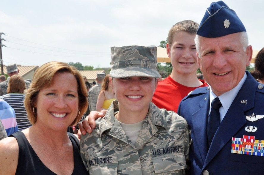 The Waltermire family surrounds Senior Airman Brigette Waltermire after she successfully completed Basic Military Training at Lackland Air Force Base, San Antonio, in 2013.