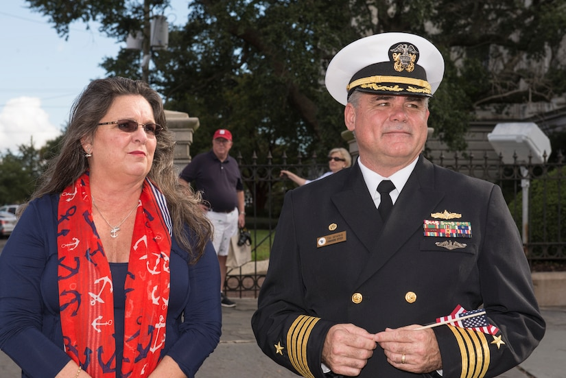 Captain Timothy Sparks, Joint Base Charleston deputy commander, with his wife, Brenda, stands in support of the Veteran's Day Parade in downtown Charleston, S.C.  Active duty military, veterans, military supporting organizations, volunteers, Junior Reserve Officer Training Corps units and the North Charleston High School marching band also were in attendance. (U.S. Air Force photo/Airman 1st Class Thomas T. Charlton)