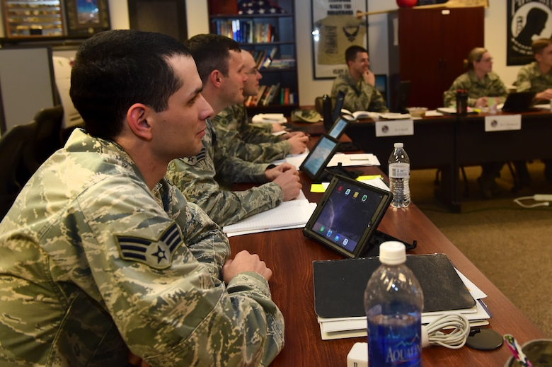 Airman Leadership School Students use iPads to better interact with instructors during class Nov. 9, 2015, on Buckley Air Force Base, Colo. ALS instructors and students utilizes the capabilities of iPads in order to improve teaching techniques and reduce resource costs. (U.S. Air Force photo by Airman 1st Class Luke W. Nowakowski/Released)