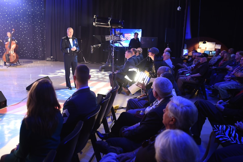 Col. Larry Lang, U.S. Air Force Band commander and conductor, speaks to the audience at the Maryland Public Television studio before a live recording of the band performing their Veteran's Day tribute compositions in Owings Mills, MD., Nov. 06, 2015. The tribute particularly recognizes Vietnam veterans with music from the 60's and 70's. (U.S. Air Force photo/Senior Airman Joshua R. M. Dewberry)