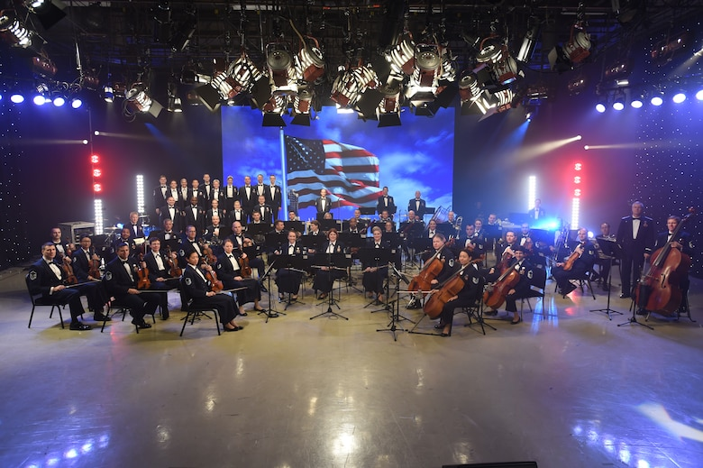 The U.S. Air Force Band poses for a photo at the Maryland Public Television studio in between takes during a live recording of the band performing their Veteran's Day tribute compositions in Owings Mills, MD., Nov. 06, 2015. The ensembles consist of the U.S. Air Force Band, Airmen of Note, the premier jazz ensemble of the U.S. Air Force, and Max Impact. (U.S. Air Force photo/Senior Airman Joshua R. M. Dewberry)