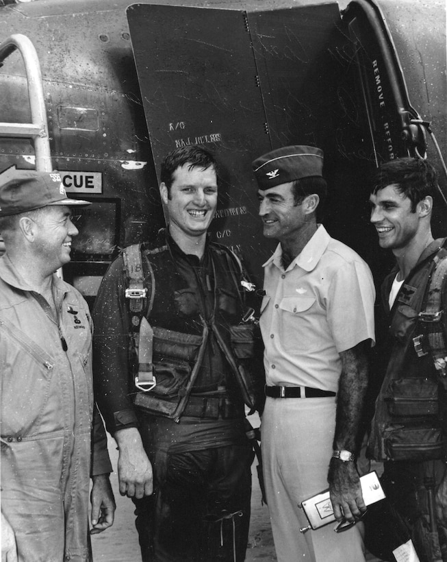 Pictured here with Sgt Ken Coats are three of the famous leaders of the 432nd Tactical Fighter Wing at Udorn RTAFB, circa 1970 after Coats received an incentive flight.  From left to right are Lt Col Joseph W. Kittinger II (later Col, also a POW), Commander of the 555th TFS, Wing Commander Col Charles Gabriel (later General and Chief of Staff of the Air Force) Sgt. Ken Coats and the squadron's Weapons Officer Capt (later Lt Gen) Richard T. Swope.  (Courtesy Ken Coats)