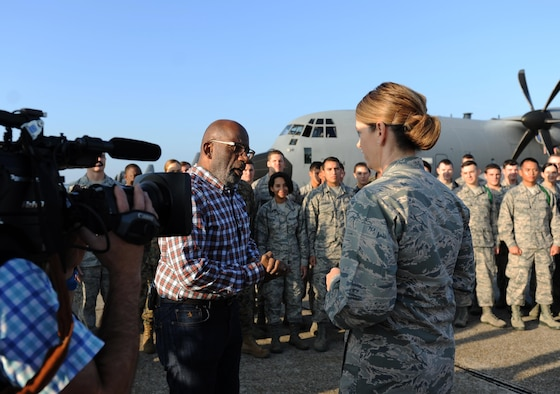 Al Roker, TODAY Show weather anchor, speaks with Col. Michele Edmondson, 81st Training Wing commander, following Roker's weather report during a segment of the TODAY Show on the flight line at Keesler Air Force Base, Miss. Nov. 11, 2015. Keesler was one stop during the show's Rokerthon 2 as Roker attempts a world record by reporting national and local weather from all 50 states. (U.S. Air Force photo by Kemberly Groue)