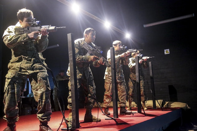 U.S. Marines with 2nd Intelligence Battalion and British soldiers rehearse combat scenarios at a Digital Combat Simulator in Edinburgh, U.K., Nov. 4, 2015. These scenarios help service members practice their shooting, communication and decision making skills to better prepare them for real life confrontations, and ultimately enhance interoperability. The forces conducted Exercise Phoenix Odyssey II which helped increase joint intelligence operations and military skills. (U.S. Marine Corps photo by Lance Cpl. Erick Galera/Released)