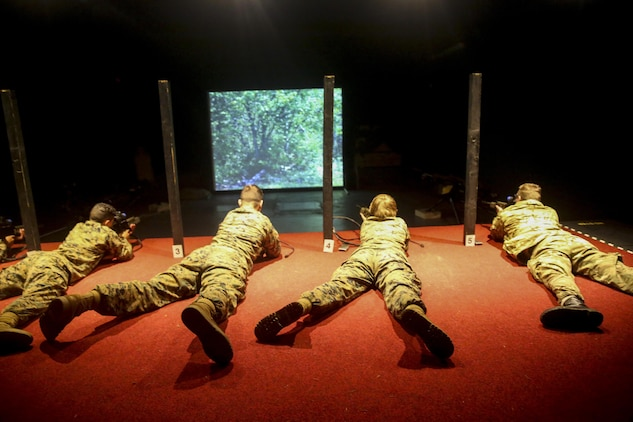 U.S. Marines with 2nd Intelligence Battalion and British soldiers rehearse combat scenarios at a Digital Combat Simulator in Edinburgh, U.K., Nov. 4, 2015. The scenario helped service members practice their shooting, communication and decision making skills to better prepare them for real life confrontations, and ultimately enhance interoperability. The forces conducted Exercise Phoenix Odyssey II which helped increase joint intelligence operations and military skills. (U.S. Marine Corps photo by Lance Cpl. Erick Galera/Released)