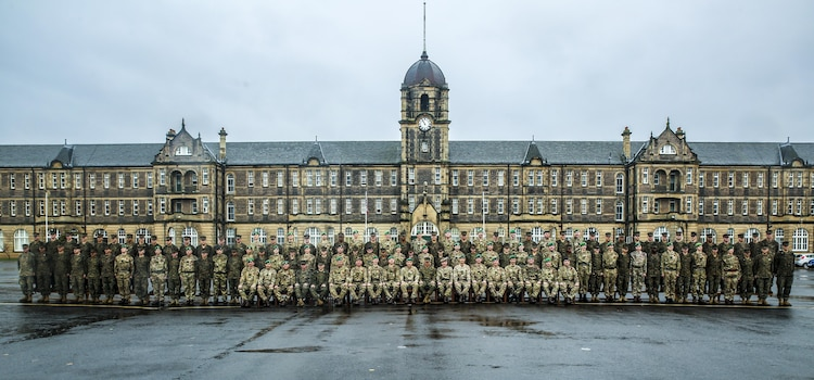 U.S. Marines with 2nd Intelligence Battalion and British soldiers pose for a photo as they conclude Exercise Phoenix Odyssey II in front of the Redford Barracks in Edinburgh, U.K., Nov. 7, 2015. This was the second consecutive year that both forces came together to conduct the exercise, which enhances joint intelligence operations and strengthens the relationship between the two forces. (U.S. Marine Corps photo by Lance Cpl. Erick Galera/Released)