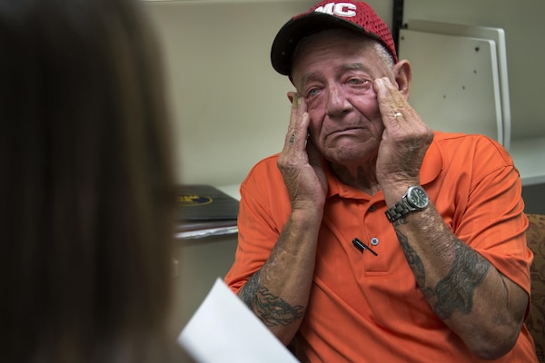 Vietnam veteran Jim Alderman reacts during a therapy session for combat-related stress at the Bay Pines Veterans Affairs Medical Center in Bay Pines, Fla. Oct. 29, 2015. Alderman recently completed a seven-week inpatient post-traumatic stress disorder program for military veterans. DoD photo by EJ Hersom