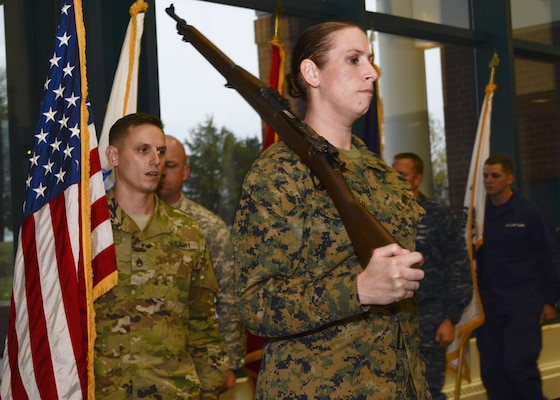 Marine Corps Sgt. Melissa L. Karnath leads the Joint Service Color Guard of the Defense Information School at Fort Meade, Md., in the school's Hall of Heroes in a Nov. 9, 2015, practice session. Members of the color guard, which includes service members from the Army, Marine Corps, Navy, Air Force and Coast Guard, participate in  ceremonies to honor the flag and the nation.