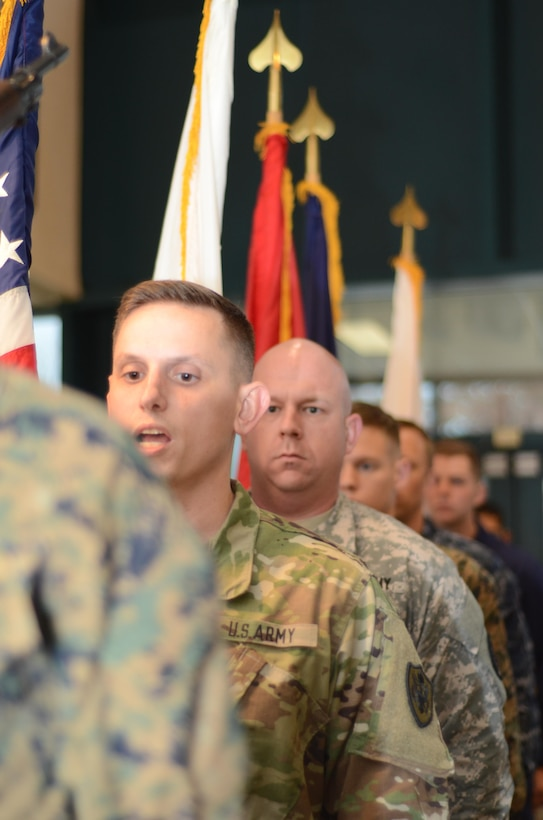 Army Staff Sgt. Jeffery Sandstrum calls cadence Nov. 9, 2015, for the Joint Service Color Guard of the Defense Information School at Fort Meade, Md., in the school's Hall of Heroes. Members of the color guard were practicing for a Veterans Day ceremony in Annapolis.