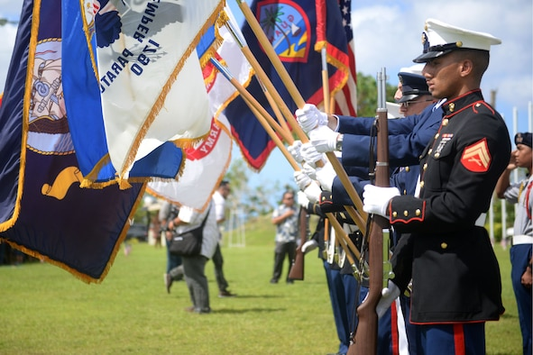 A joint service color guard presents the colors during the 2015 Veterans Day ceremony Nov. 11 in Adelup, Guam. Veterans Day honors and recognizes the personal sacrifices put forth by previous generations of servicemembers and our current servicemembers.  (U.S. Air Force photo by Senior Airman Joshua Smoot/Released)
