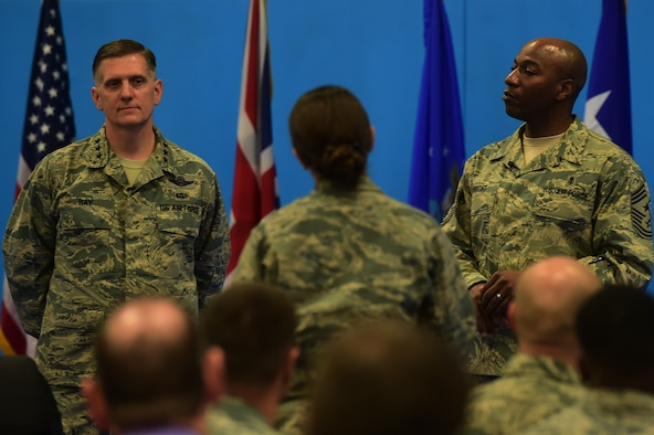 Lt. Sara Esau, the 422nd Air Base Group executive officer, asks Lt. Gen. Timothy Ray, the 3rd Air Force and 17th Expeditionary Air Force commander and Chief Master Sgt. Kaleth Wright, the 3rd Air Force and 17th Expeditionary Air Force command chief, a question during an all-call at RAF Croughton, United Kingdom, Nov. 10, 2015. During the event Ray and Wright both spoke to the Airmen about their priorities and keys to success.  (U.S. Air Force photo by Master Sgt. Chrissy Best/Released)