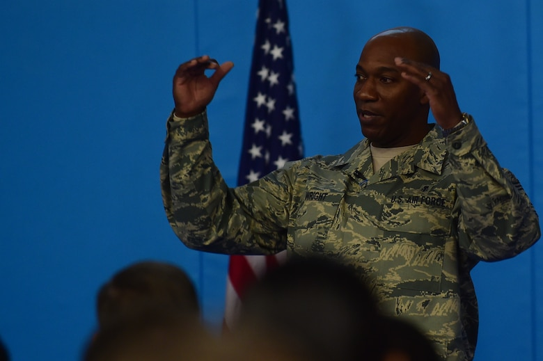 "Chief Master Sgt. Kaleth Wright, the 3rd Air Force and 17th Expeditionary Air Force command chief, speaks to Airmen during an all-call at RAF Croughton, United Kingdom, Nov. 10, 2015. During the all-call, Wright spoke about character, attitude, discipline, excellence and teamwork (CADET), which he calls the ""Five keys to Success"".  (U.S. Air Force photo by Master Sgt. Chrissy Best/Released)"