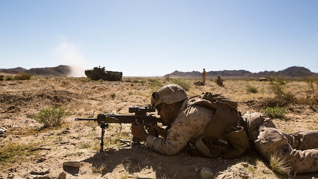 A U.S. Marine Corps rifleman with Alpha Company, 1st Battalion, 8th Marine Regiment, 2nd Marine Division, fires rounds at an enemy as his fire team prepares to push towards their next objective in a mechanized assault course during Integrated Training Exercise 1-16 aboard Marine Corps Air Ground Combat Center Twentynine Palms, Calif., Oct. 30, 2015. Marines participate in a month-long field exercise demonstrating core mission essential tasks by conducting offensive, defensive and stability operations using combined arms, air integration, and battalion-level infantry tactics in order to strengthen operational readiness as they prepare for world-wide deployment.