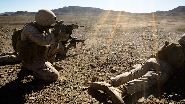 U.S. Marines with Alpha Company, 1st Battalion, 8th Marine Regiment, 2nd Marine Division, lay suppressive fire down range on the final objective to suppress enemy fire in a mechanized assault course during Integrated Training Exercise 1-16 aboard Marine Corps Air Ground Combat Center Twentynine Palms, Calif., Oct. 30, 2015. Marines participate in a month-long field exercise demonstrating core mission essential tasks by conducting offensive, defensive and stability operations using combined arms, air integration, and battalion-level infantry tactics in order to strengthen operational readiness as they prepare for world-wide deployment.