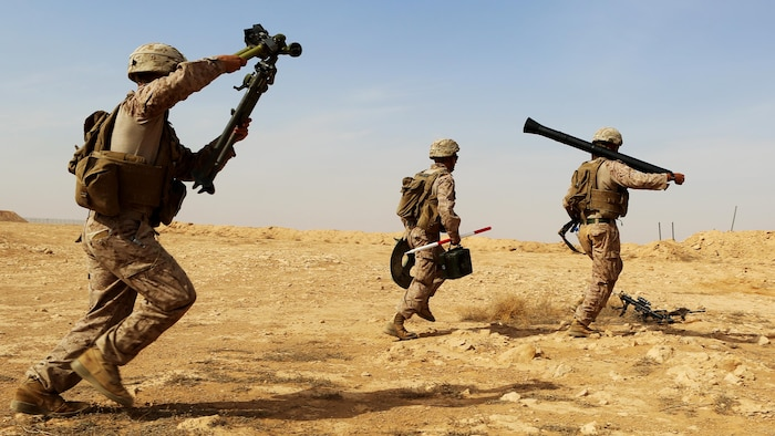 U.S. Marines with Weapons Company, 1st Battalion, 7th Marine Regiment, Special Purpose Marine Air-Ground Task Force--Crisis Response--Central Command, rush with their weapons system as they conduct live-fire training on the new M252A2 81mm mortar system at Al Asad Air Base, Iraq, Oct. 24, 2015.  The training allowed the Marines, who are charged with providing security of Al Asad, an opportunity to hone their tactics, techniques and procedures in employment of the system, further reinforcing their ability to provide protection to their coalition and Iraqi Security Force partners as part of the Combined Joint Task Force – Operation Inherent Resolve's building partner capacity mission.