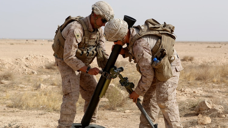 U.S. Marines with Weapons Company, 1st Battalion, 7th Marine Regiment, Special Purpose Marine Air-Ground Task Force--Crisis Response--Central Command, assemble a new M252A2 81mm mortar system during a live-fire training mission at Al Asad Air Base, Iraq, Oct. 24, 2015. The training allowed the Marines to build their proficiency with the new weapons system.  This unit is supporting the Combined Joint Task Force – Operation Inherent Resolve, which is a coalition of regional and international nations who have joined together to defeat the Islamic State of Iraq and the Levant and the threat they pose to Iraq, Syria, the region and the wider international community.