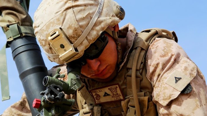 U.S. Marine Lance Cpl. Matthew Parra, a fires direction center coordinator with Weapons Company, 1st Battalion, 7th Marine Regiment, Special Purpose Marine Air-Ground Task Force--Crisis Response--Central Command, performs gun drills during a live-fire training mission at Al Asad Air Base, Iraq, Oct. 24, 2015.  The training allowed the Marines to become familiar with the M252A2 81mm mortar system as they honed their tactics, techniques and procedures in employment of the weapon.  This unit is supporting Combined Joint Task Force – Operation Inherent Resolve, a coalition of regional and international nations who have joined together to enable Iraqi forces to counter the Islamic State of Iraq and the Levant.